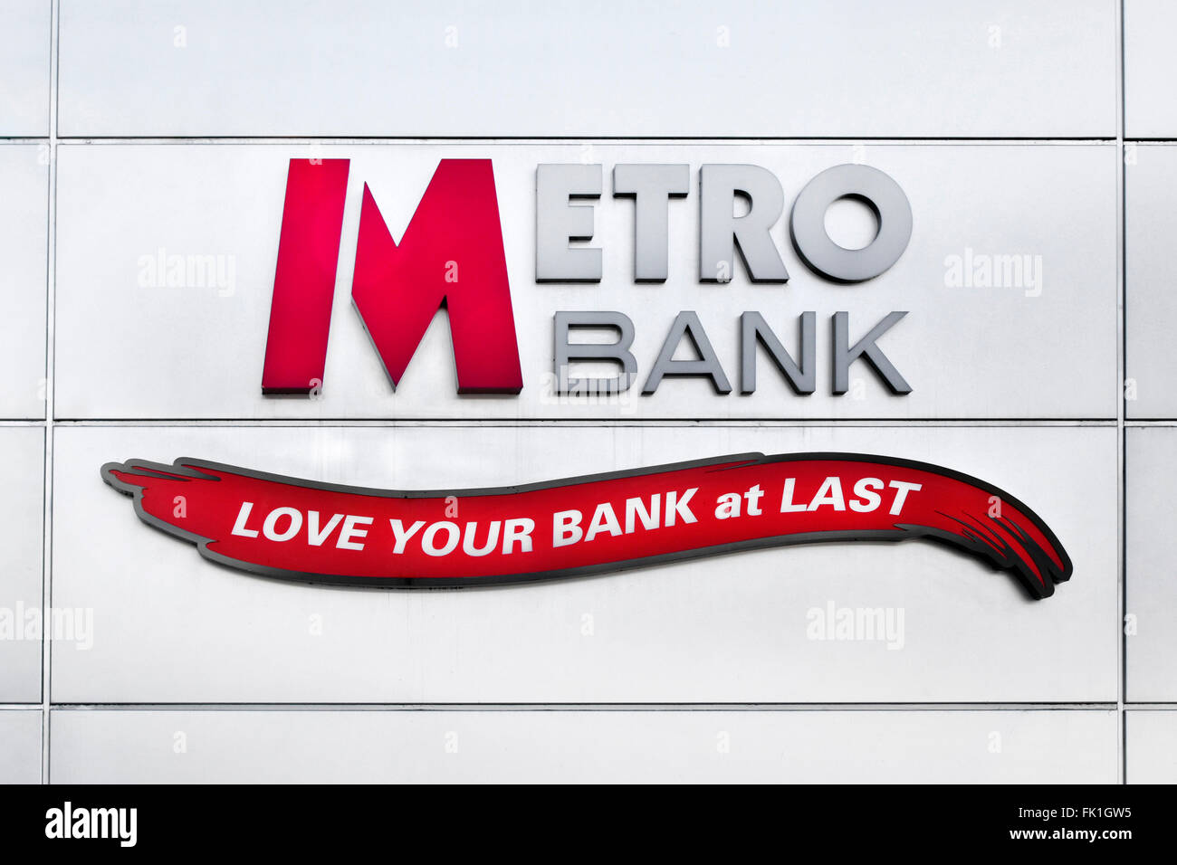 Metro Bank logo and slogan love your bank on wall of new banking branch building in Romford Havering East London - Stock Image