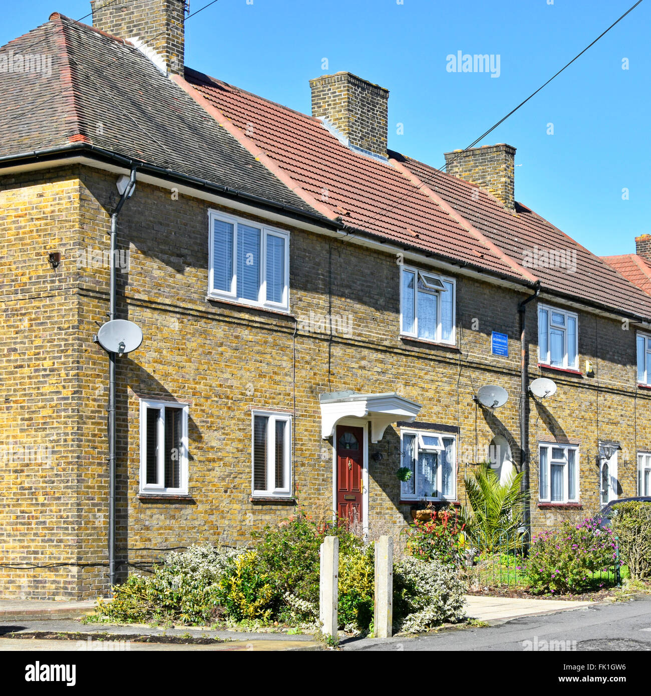 Council estate first block of houses completed on LCC Becontree Housing Estate 1921 recorded on blue plaque now - Stock Image