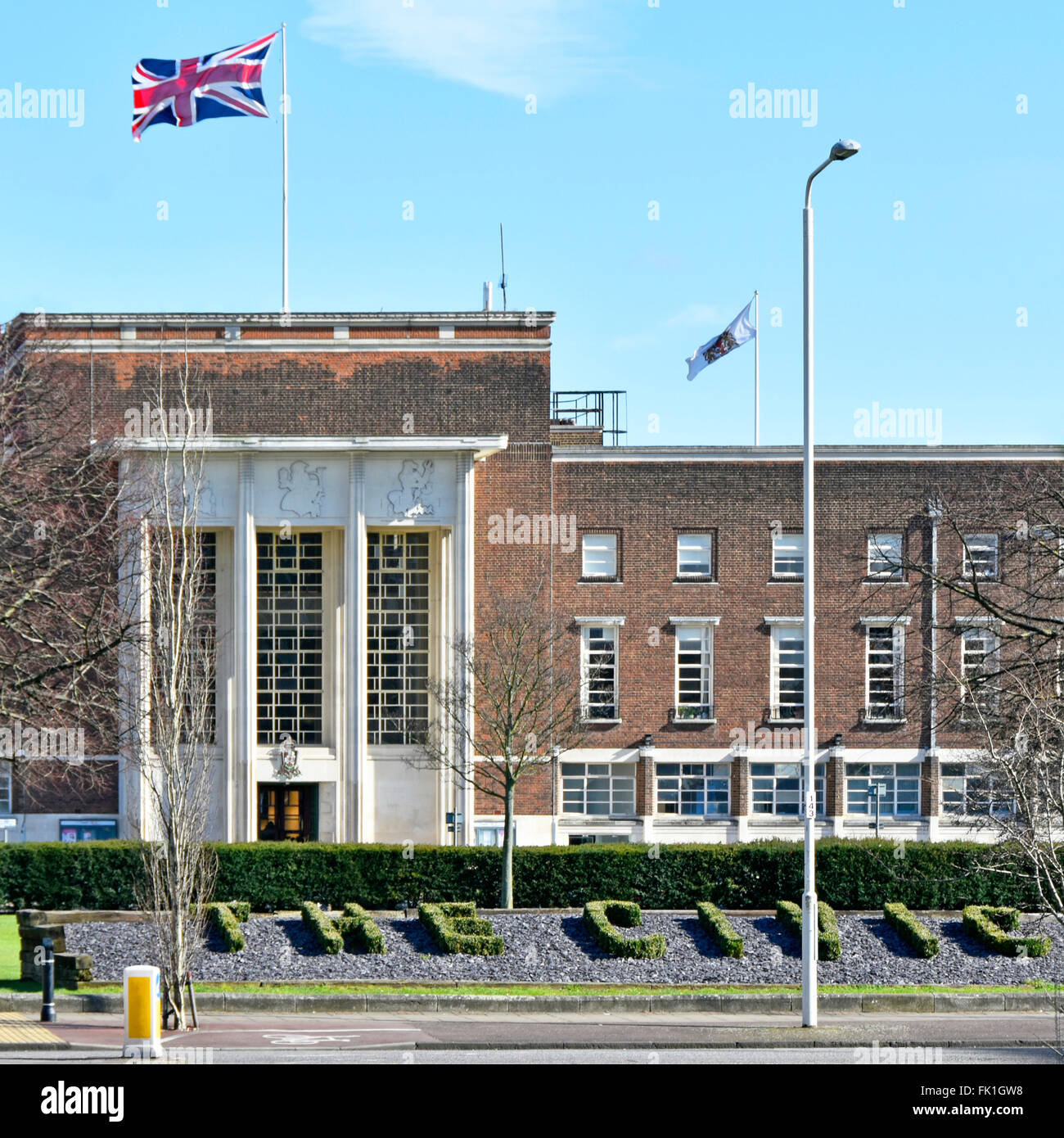 Town Hall offices in original Dagenham Civic Centre with The Civic sign formed in topiary all now part of East London - Stock Image