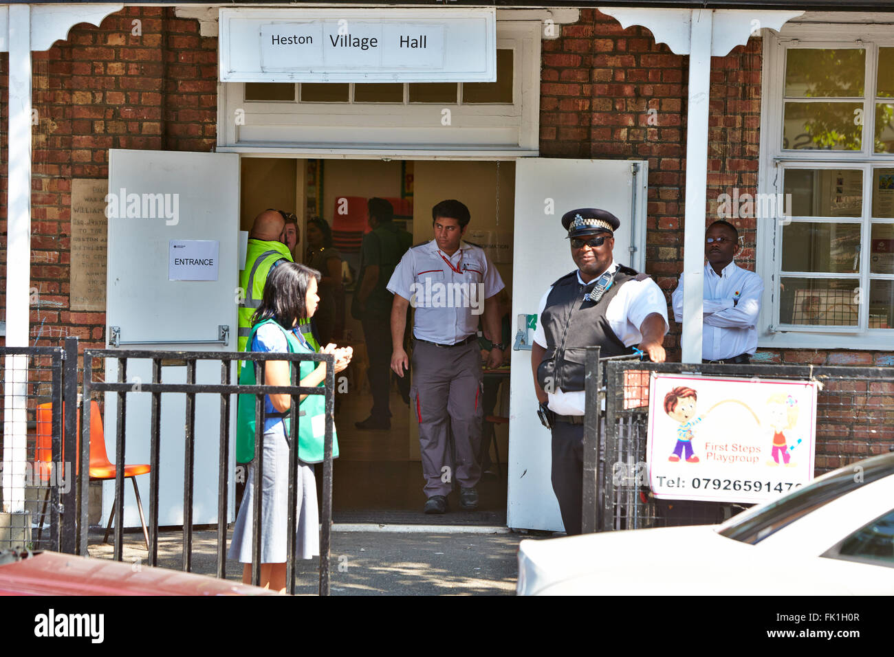 Local residents evacuated to the village hall following a fatal fire in a flat above a shop on New Heston Road. - Stock Image