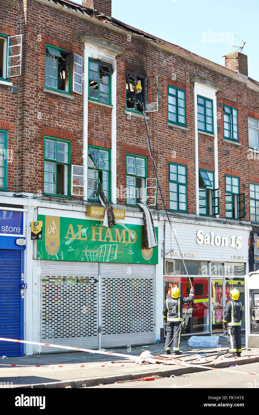 The scene of a fatal fire in a flat above a shop on New Heston Road in Hounslow - Stock Image