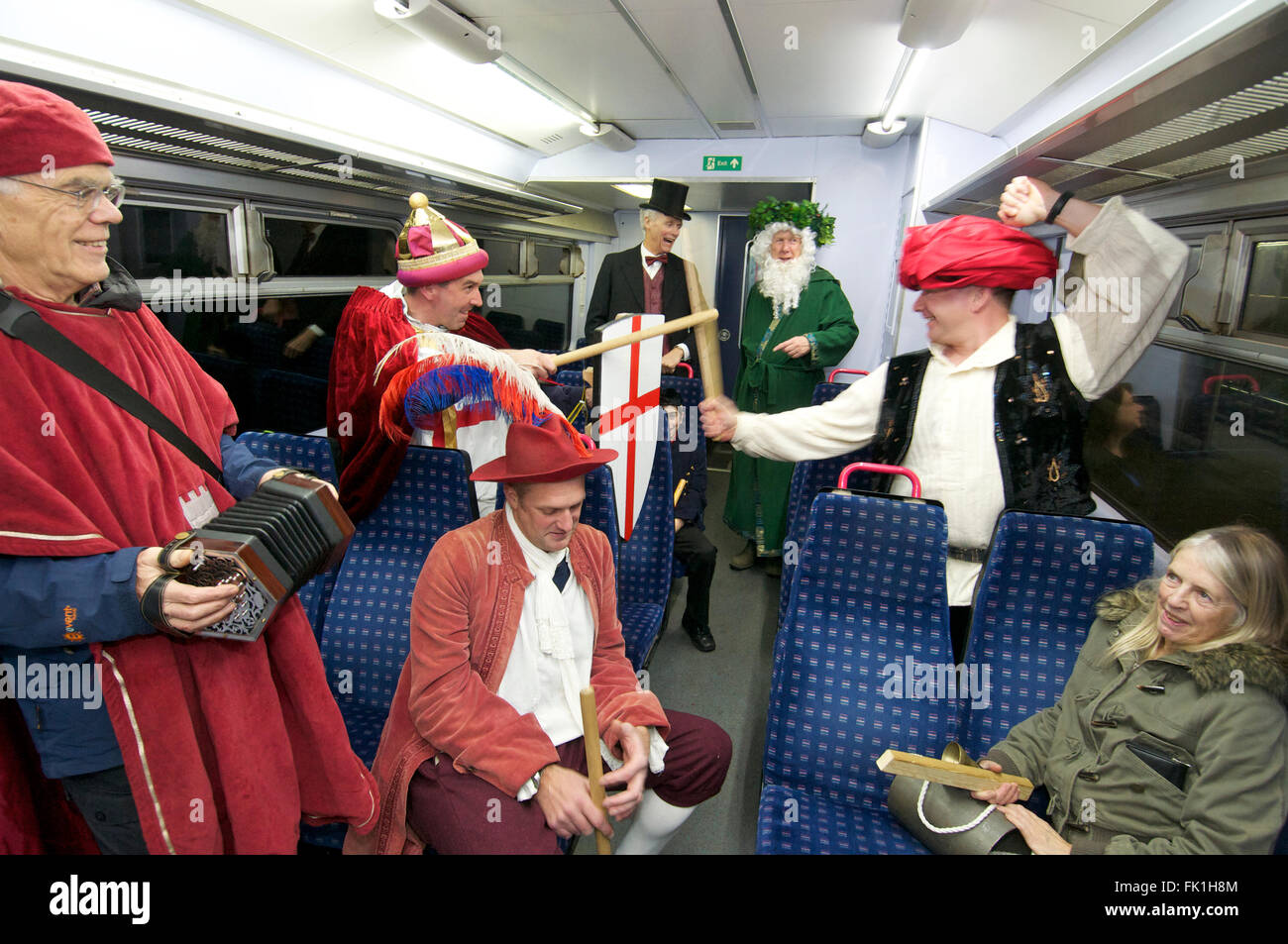 Mummers perform on a train, UK - Stock Image