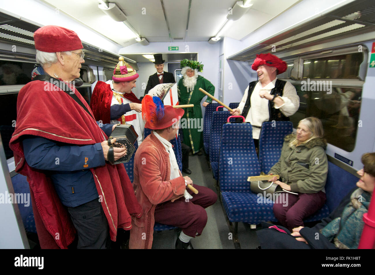 Lympstone Mummers perform on a train, Devon UK - Stock Image