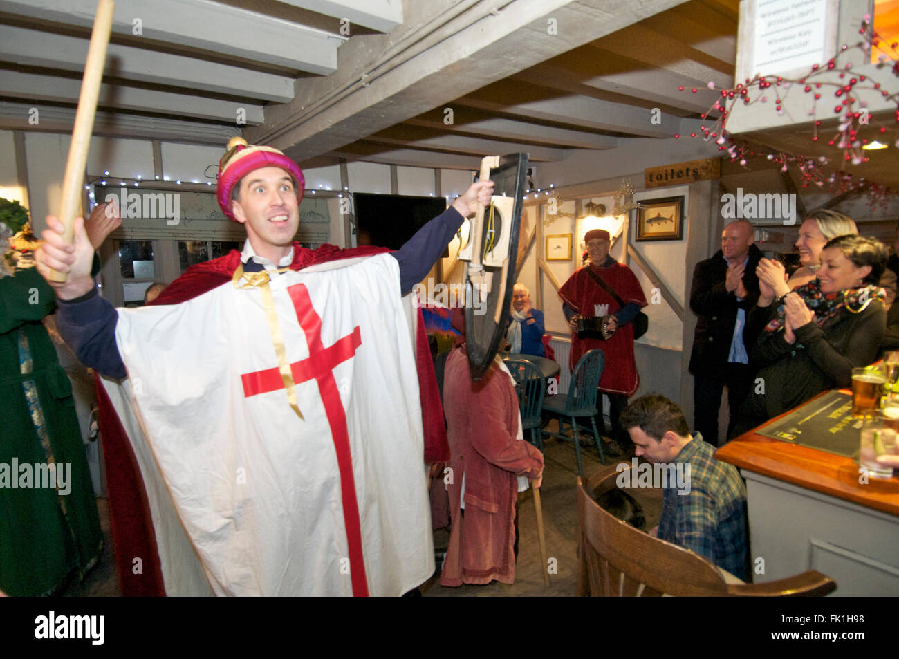 St George victorious as  Mummers perform in a pub, UK - Stock Image