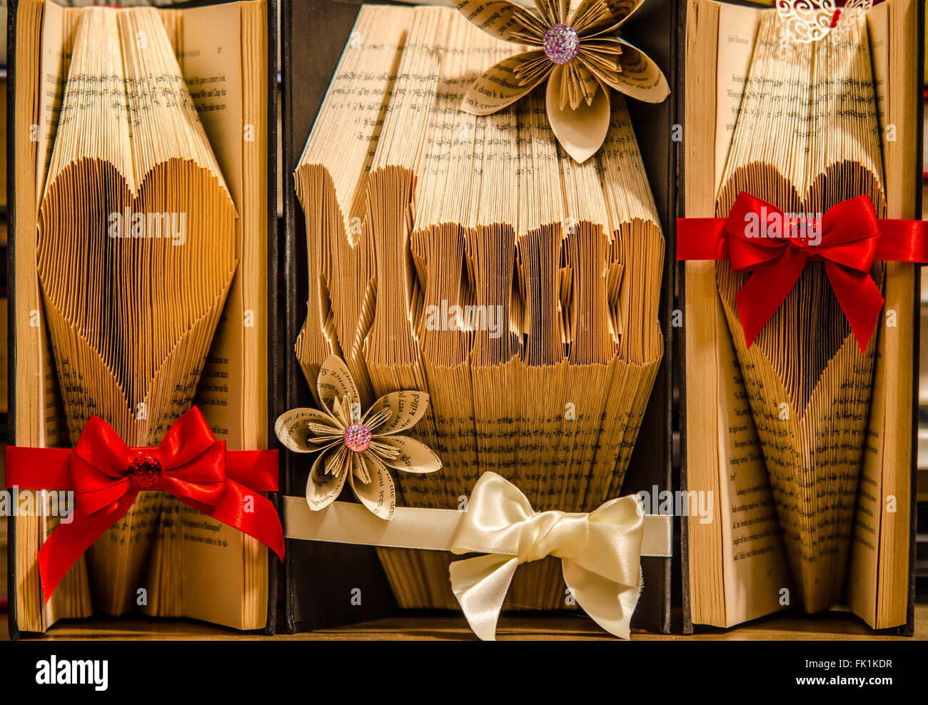 Book Folding. Art created by folding the pages of a hardback book to form images or words. They can be decorated - Stock Image