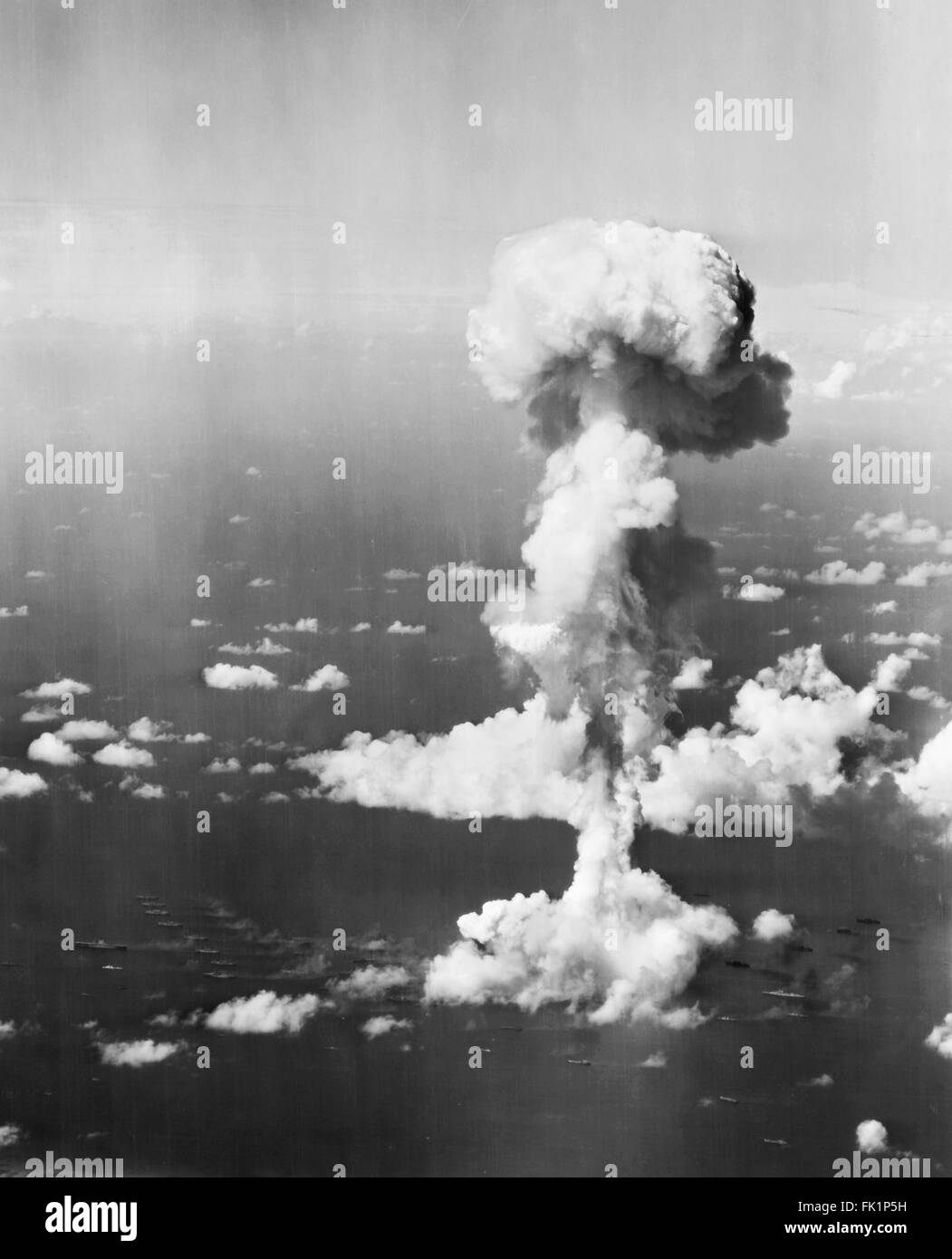 Nuclear Explosion. Ships beneath the mushroom cloud from Operation Crossroads nuclear weapons test at Bikini Atoll, Stock Photo