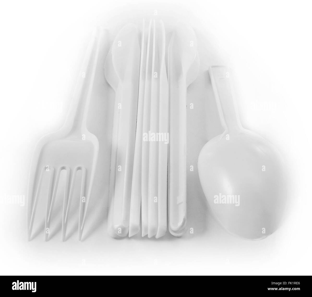 plastic spoons and forks - Stock Image