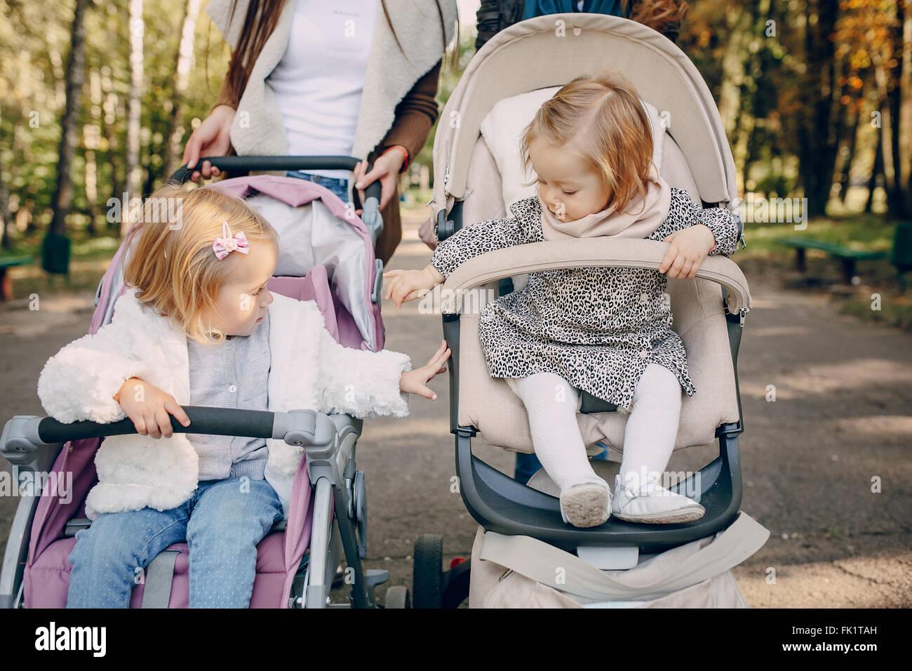 Family walk in the park - Stock Image