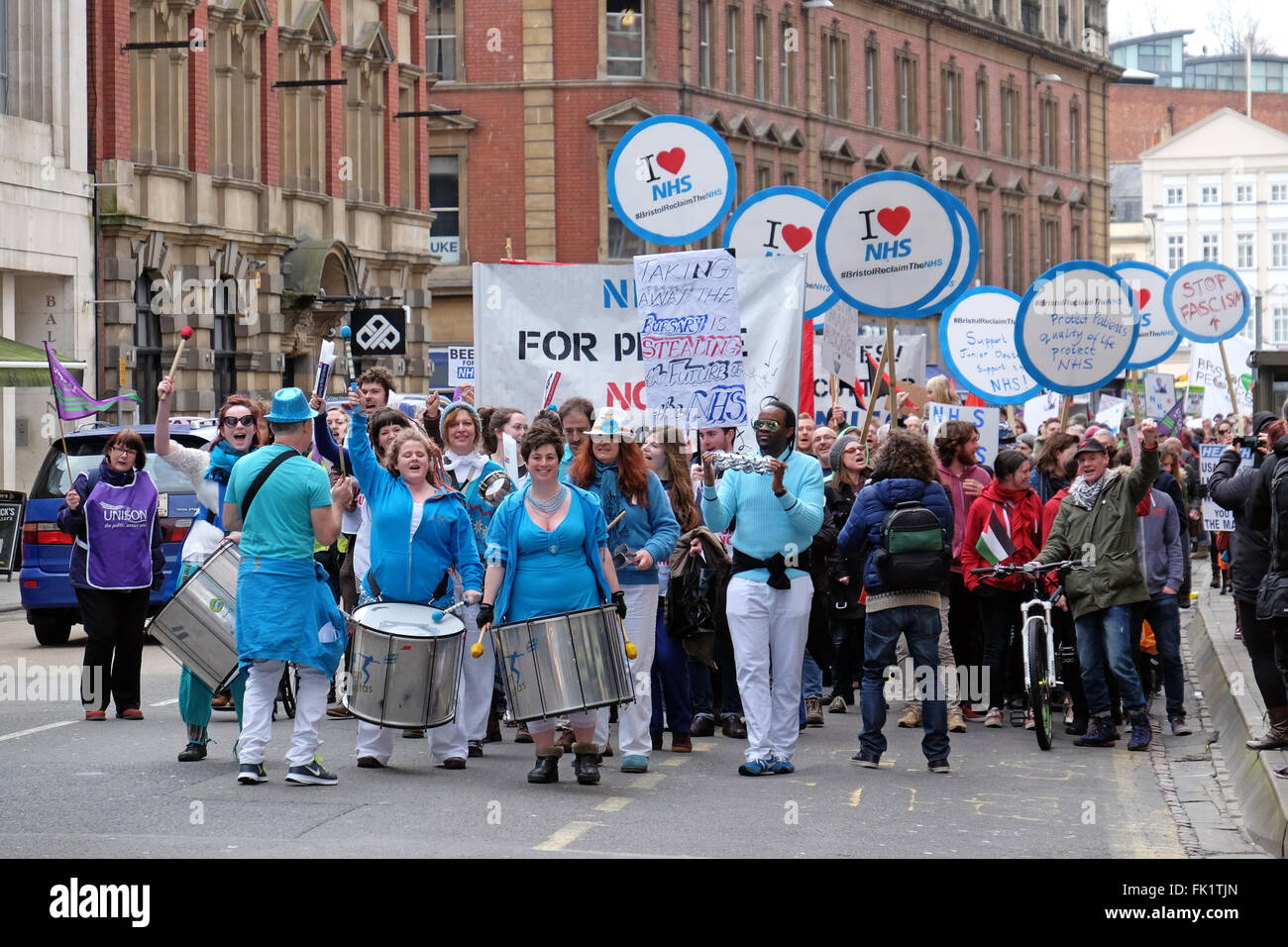 Protestors against planned changes to the National Health Service march through the streets of Bristol, England. - Stock Image