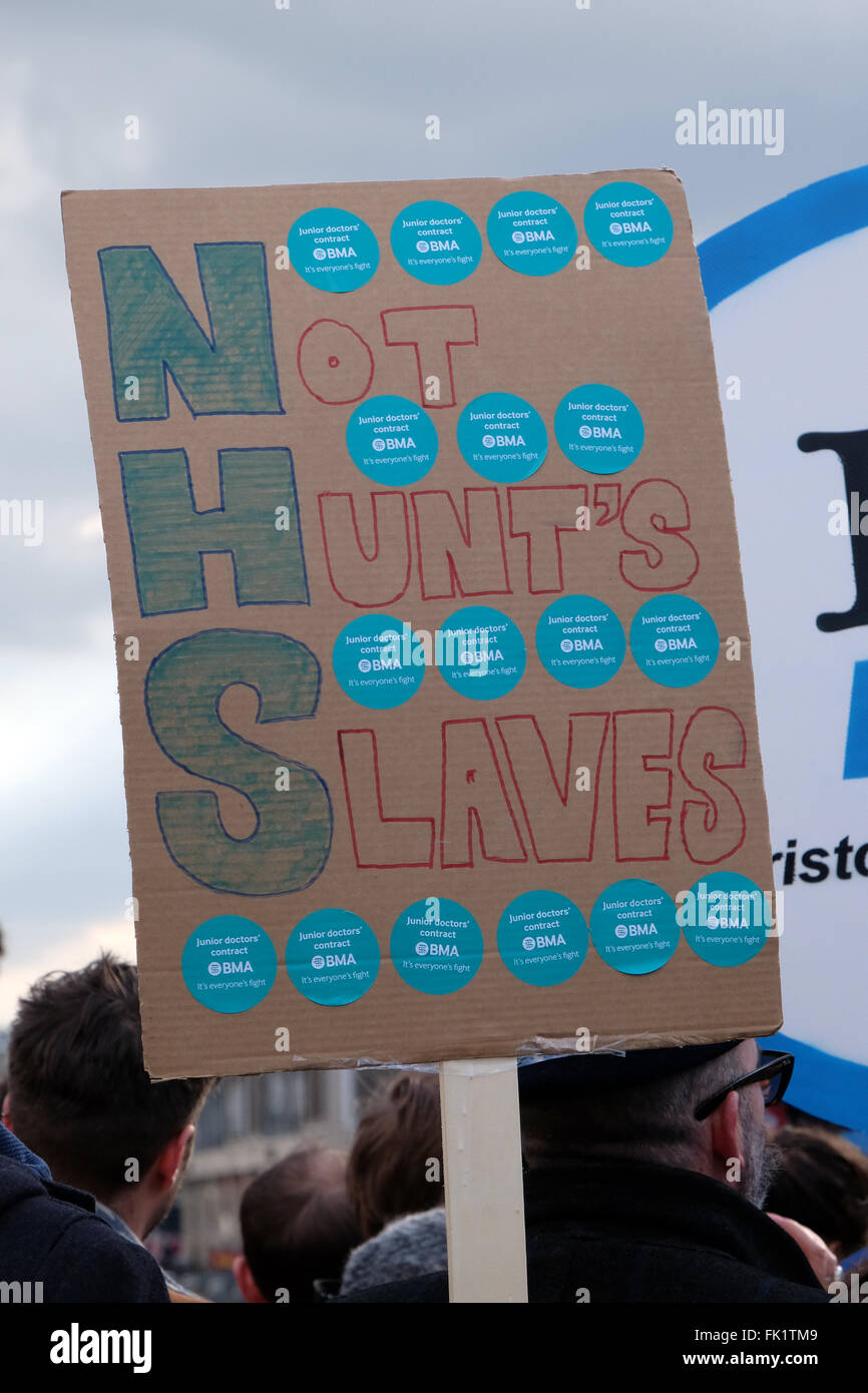A placard carried by a protestor against planned changes to the National Health Service during a march through the - Stock Image