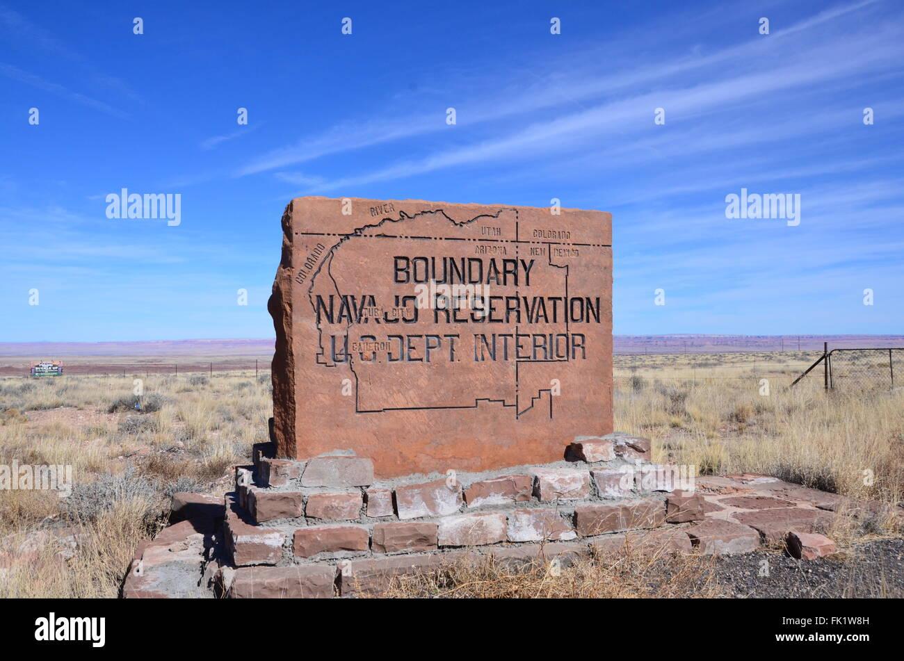 navajo reservation boundary sign arizona blue sky sunny day - Stock Image