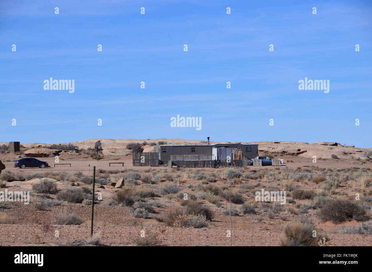navajo indian reservation housing shacks poverty cars - Stock Image