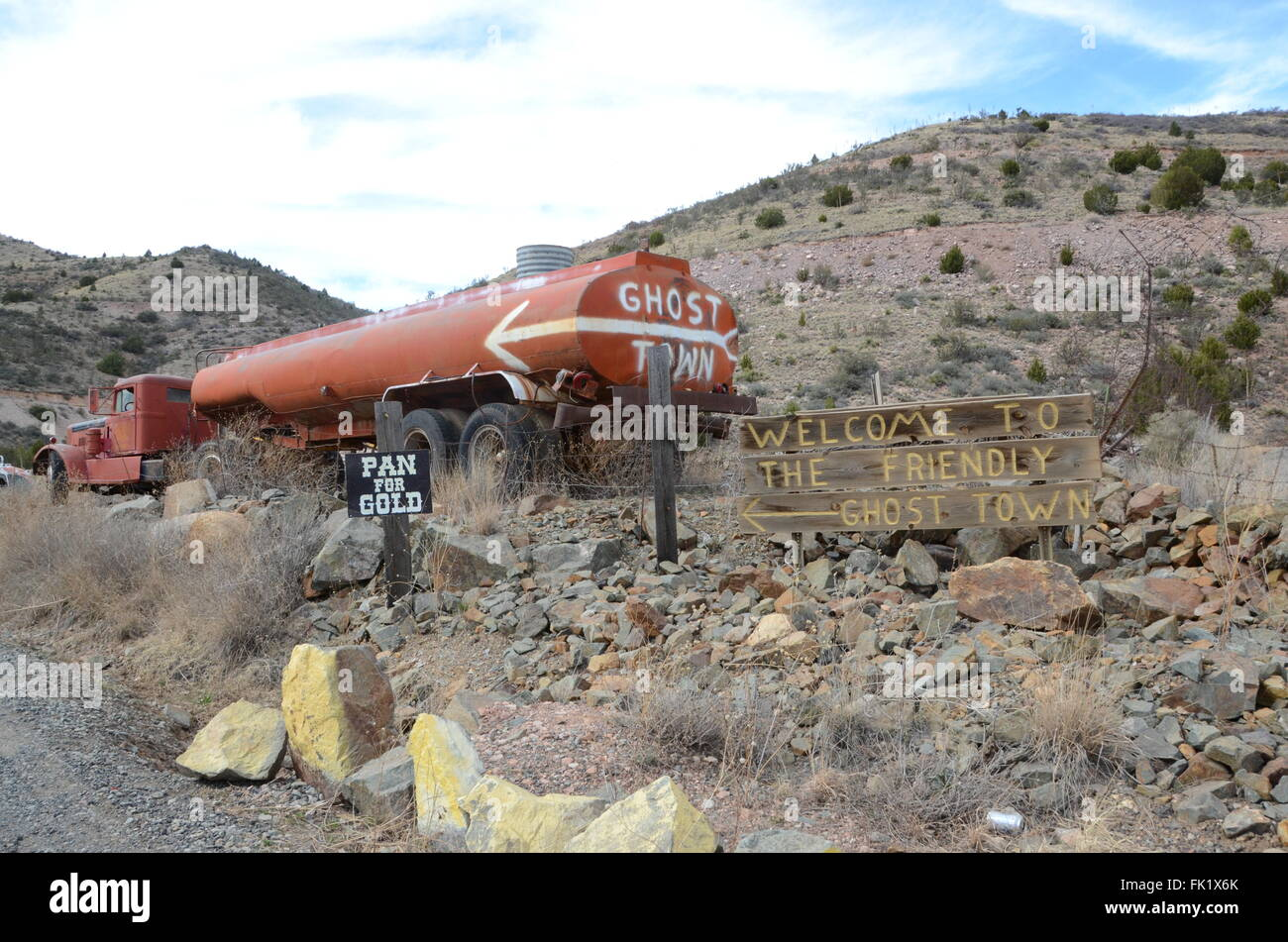 ghost town written on old gas truck gold king hill jerome arizona welcome sign scrub land - Stock Image