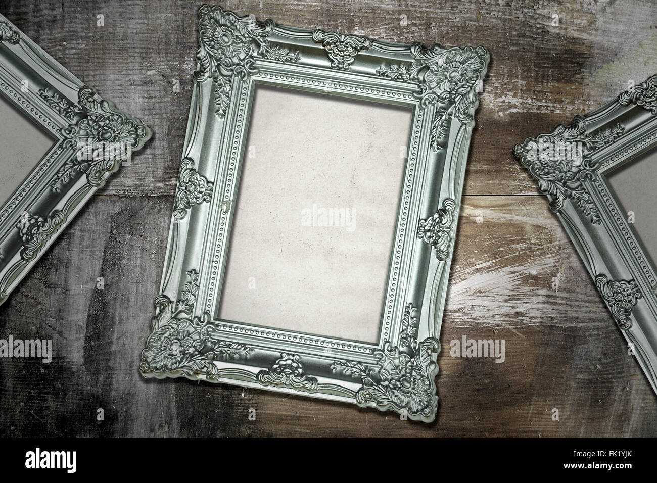 Silver Antique Frames on Weathered Wood Background Stock Photo ...