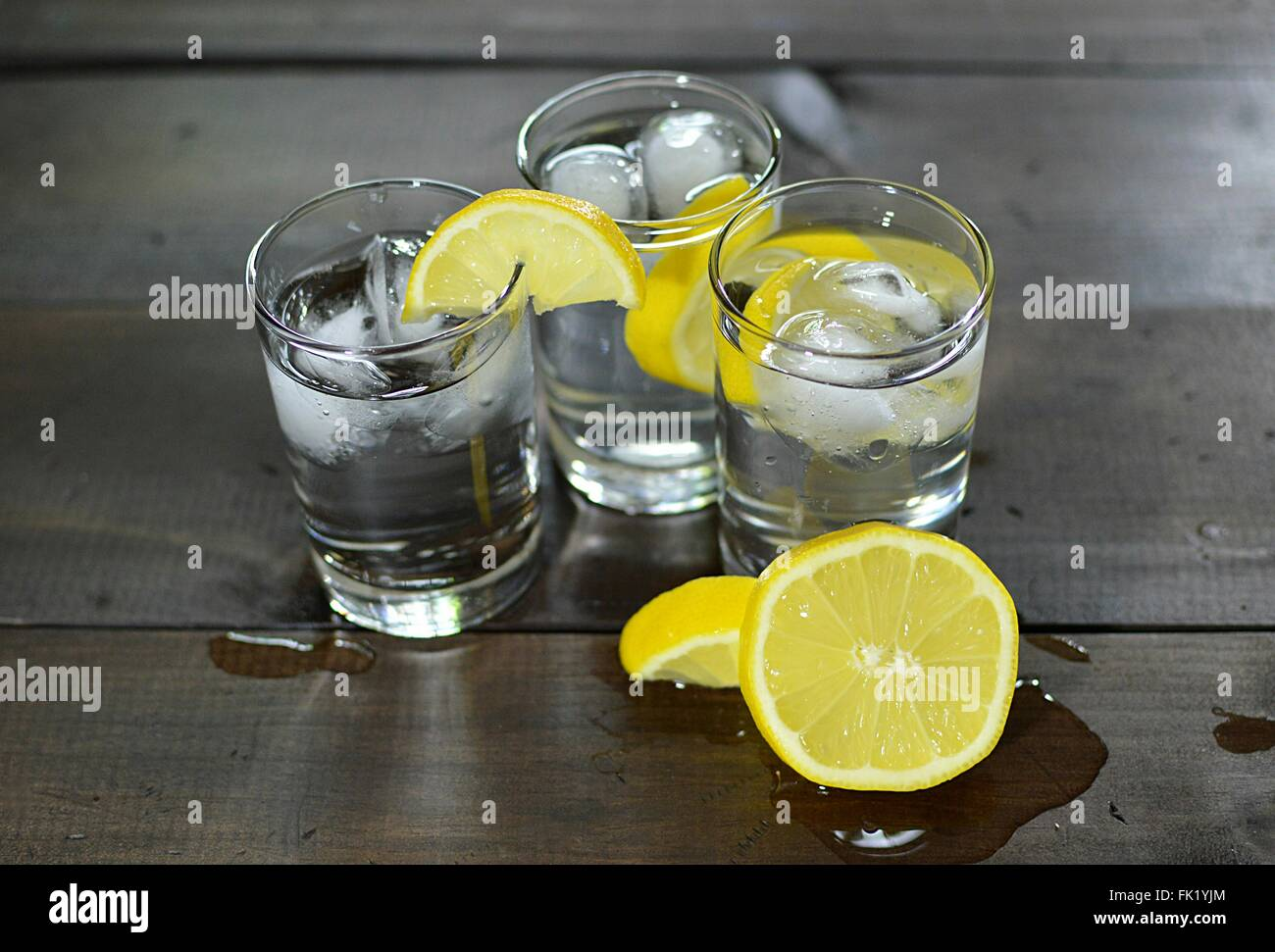 High angel view of glasses of water and lemon slices. - Stock Image
