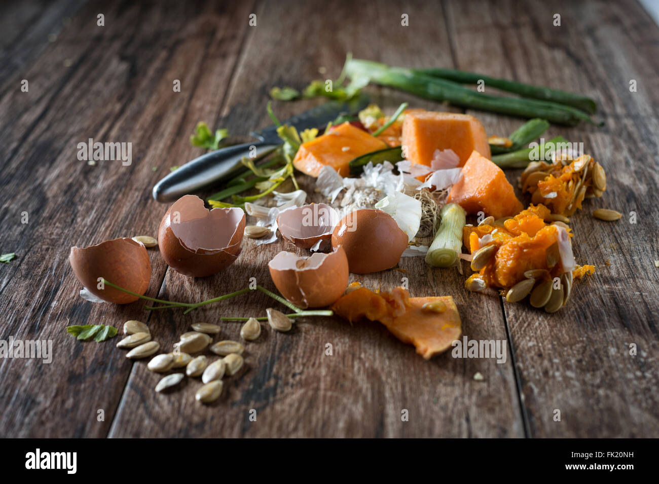 Organic leftovers, waste from vegetable ready for recycling and to compost. Collecting food leftovers for composting. - Stock Image