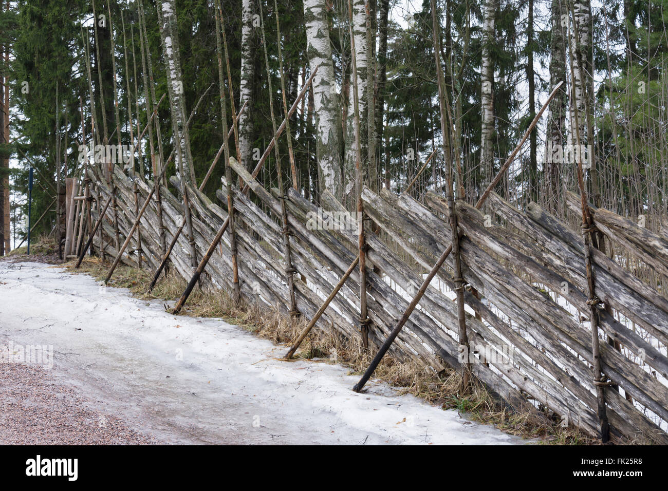Traditional roundpole fence at Seurasaari Open-Air Museum - Stock Image