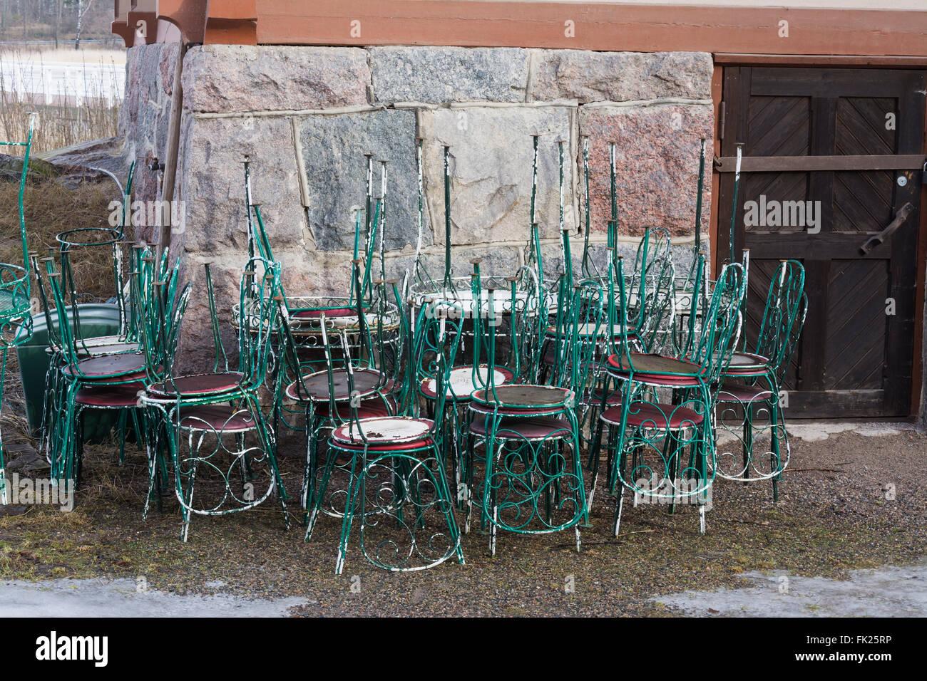 Piled Cafe Chairs at Seurasaari Open-Air Museum - Stock Image