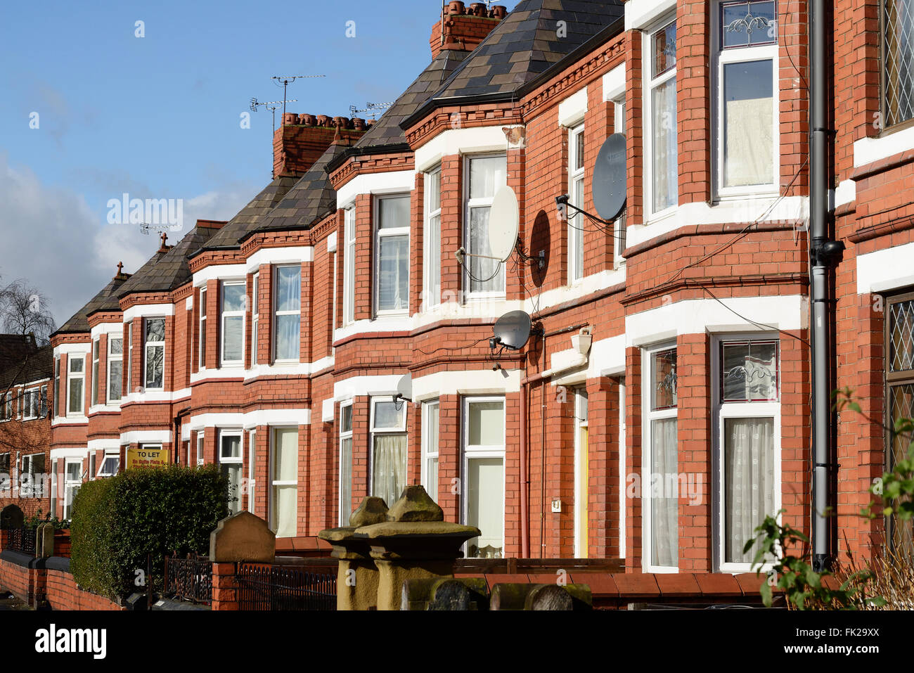 Row of bay fronted Victorian terraced houses Stock Photo