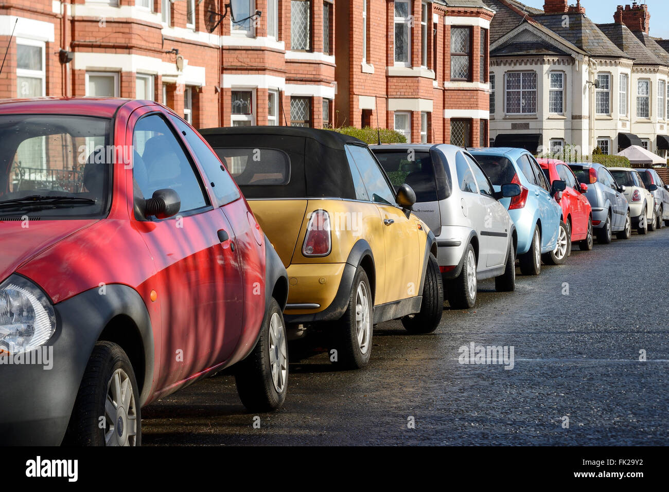 Cars parked on the side of a road - Stock Image