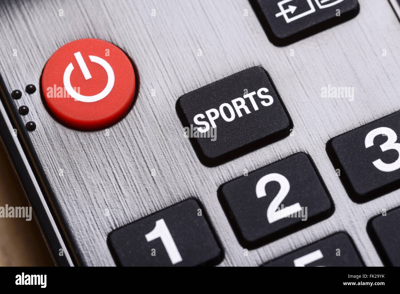 Close up detail of a Sport and on off button on a TV remote control - Stock Image