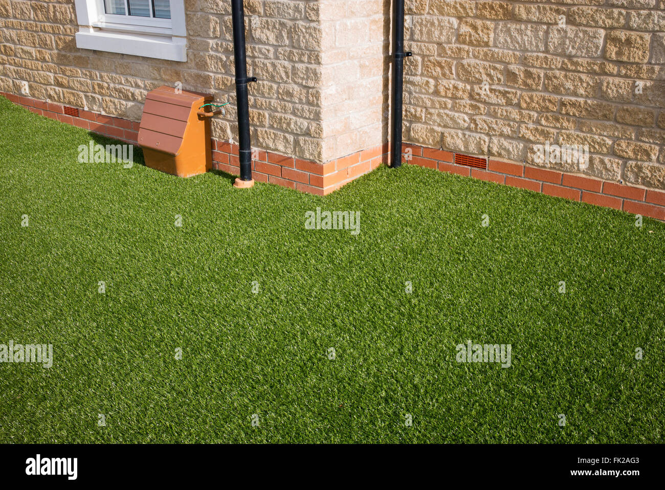 Artificial grass / astro turf on a new build housing estate. Bicester, Oxfordshire, England - Stock Image