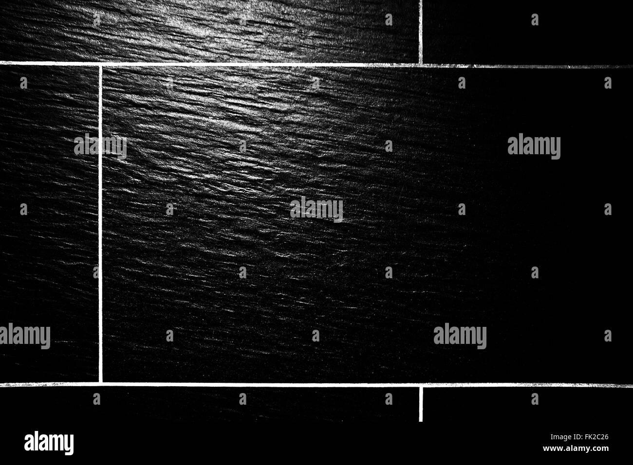 Grey floor tiles - Stock Image