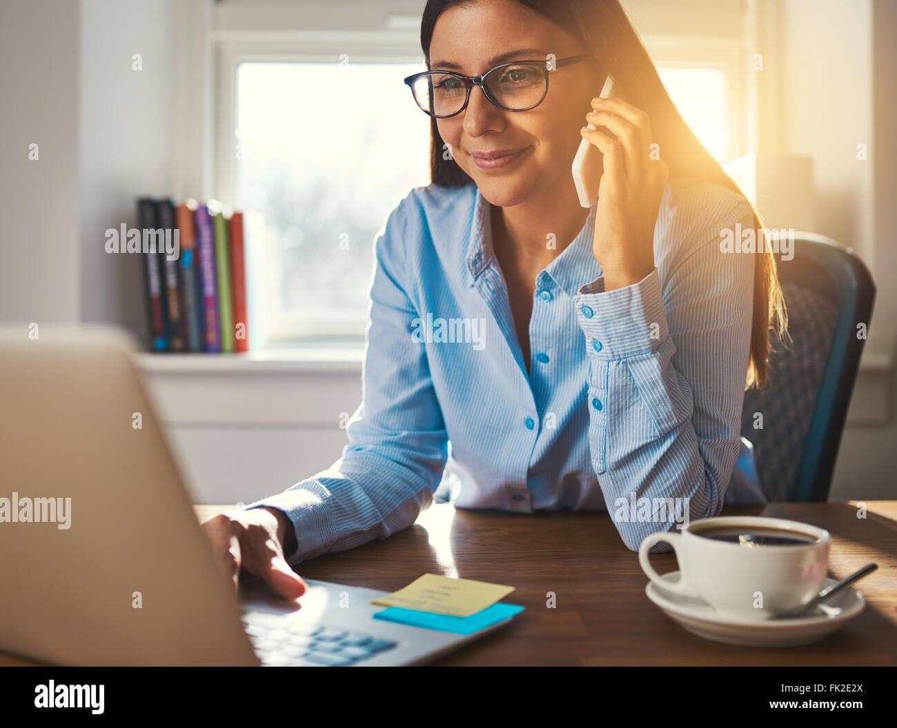 Female entrepreneur working at desk business woman concept - Stock Image