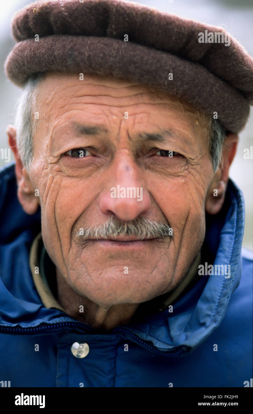 Close up of a Pakistani man in the village of Karimabad, Hunza Valley, Pakistan - Stock Image