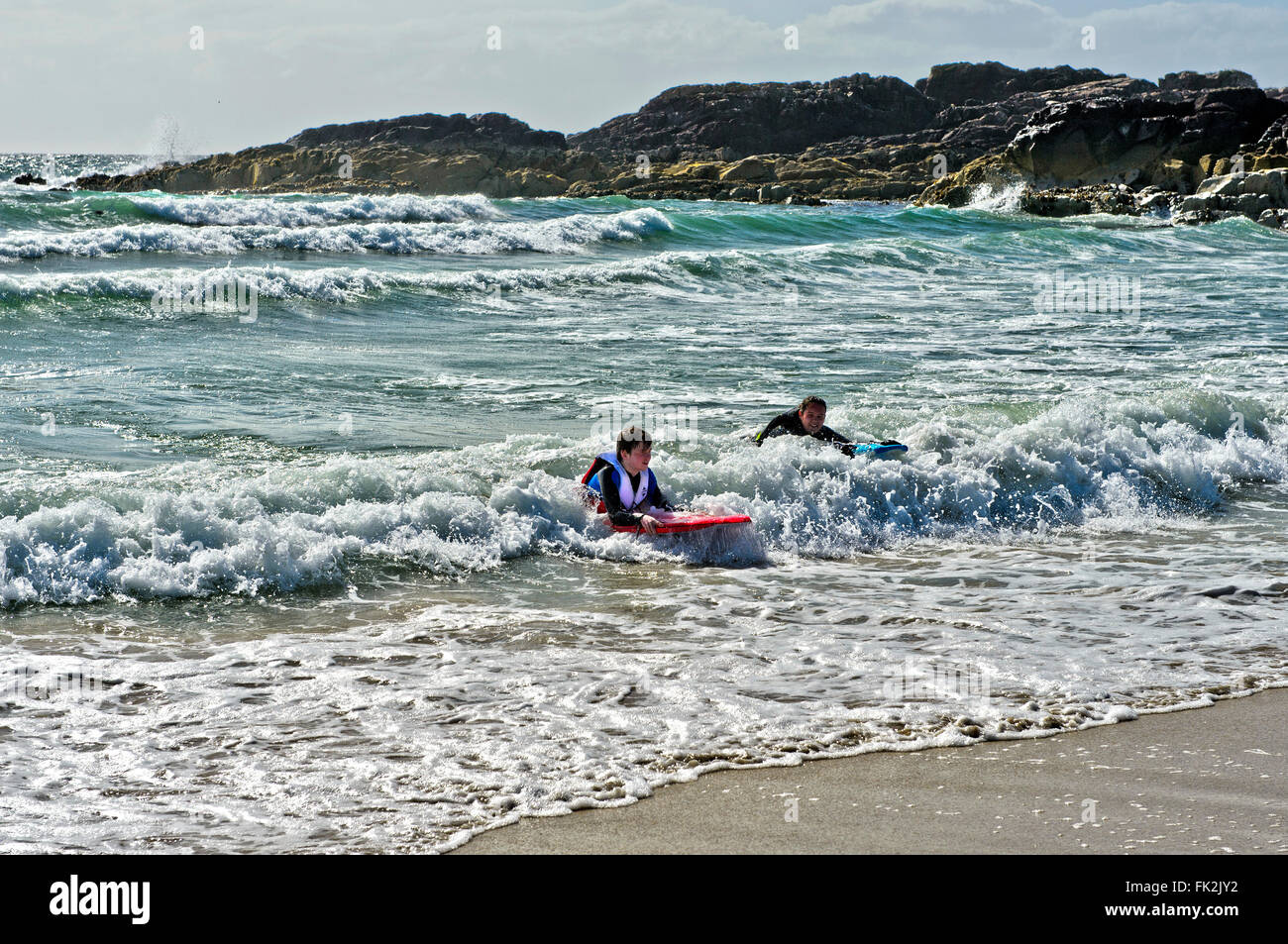 Swimmers in the surf at the Clachtoll Bay, Clatchtoll, Assynt, Scotland, United Kingdom - Stock Image