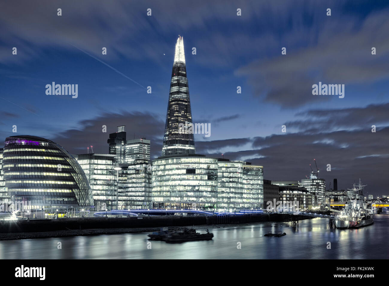 The London skyline in Southwark showing the Shard and City Hall, at night - Stock Image