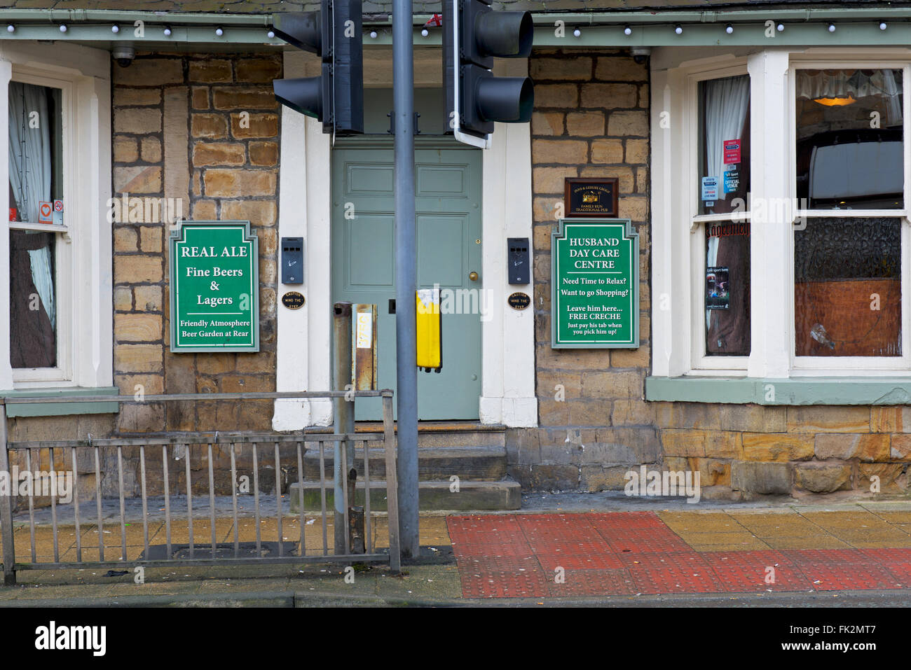 Sign on pub - day care for husbands - England UK - Stock Image