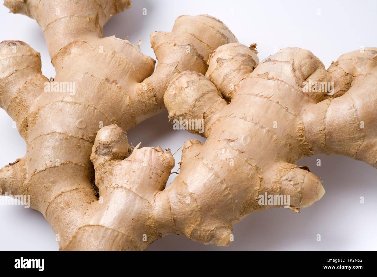 Fresh Ginger roots on white background - Stock Image