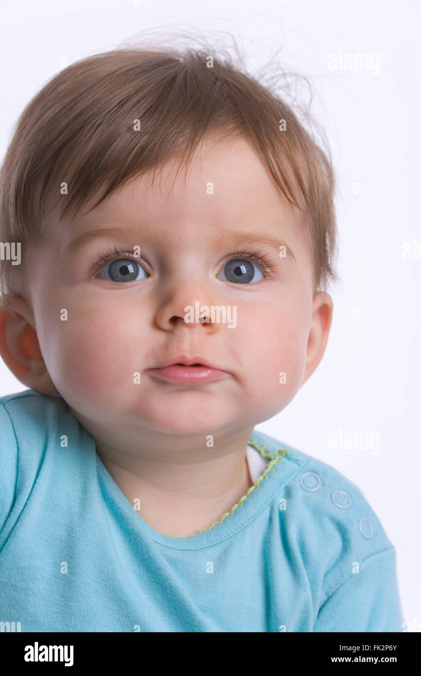 Portrait Of A Baby Girl On White Background - Stock Image