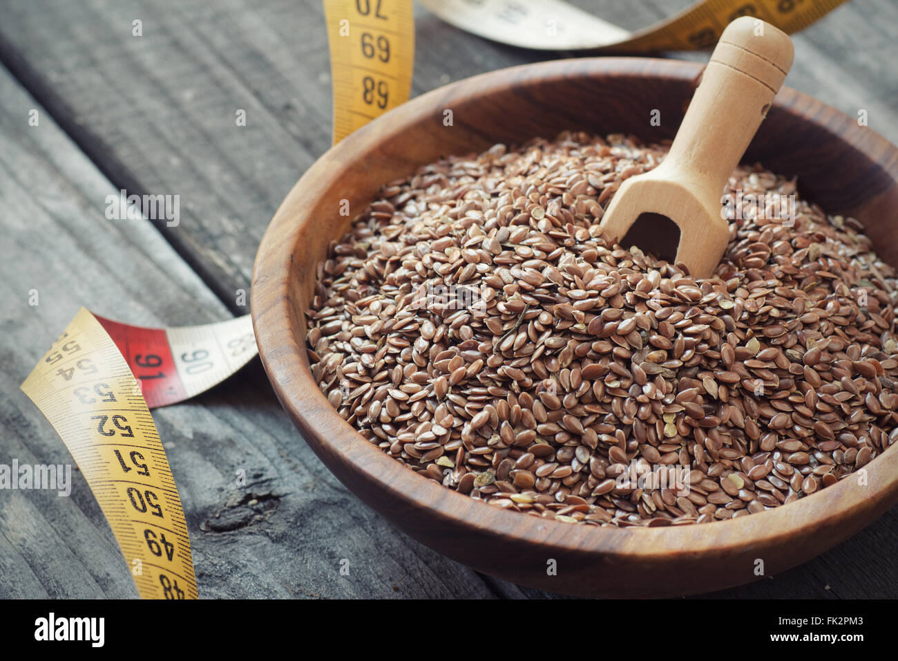 Flax seeds and measuring tape, weight reduction concept - Stock Image