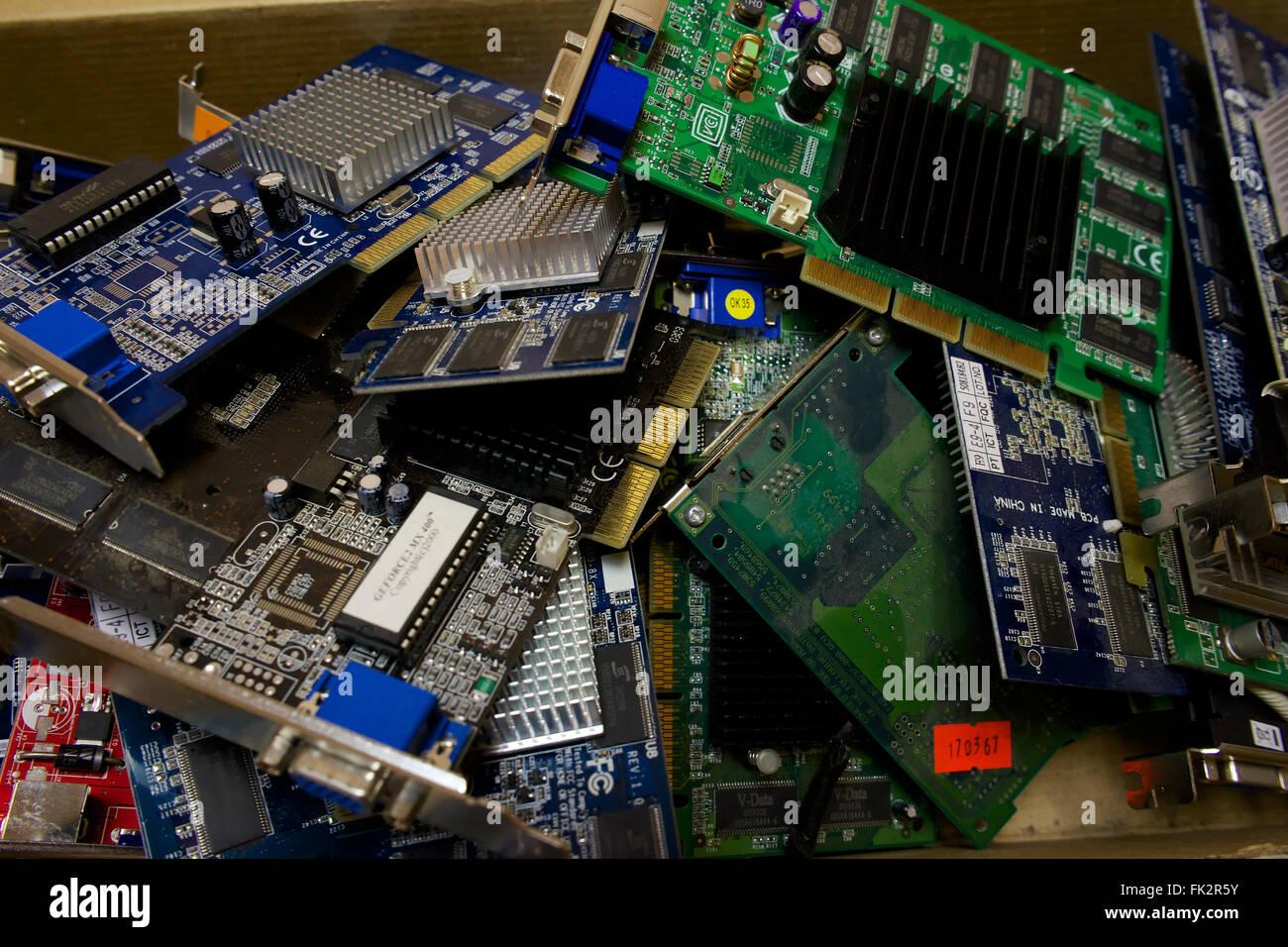 Landfill computer components. Broken equipment. - Stock Image