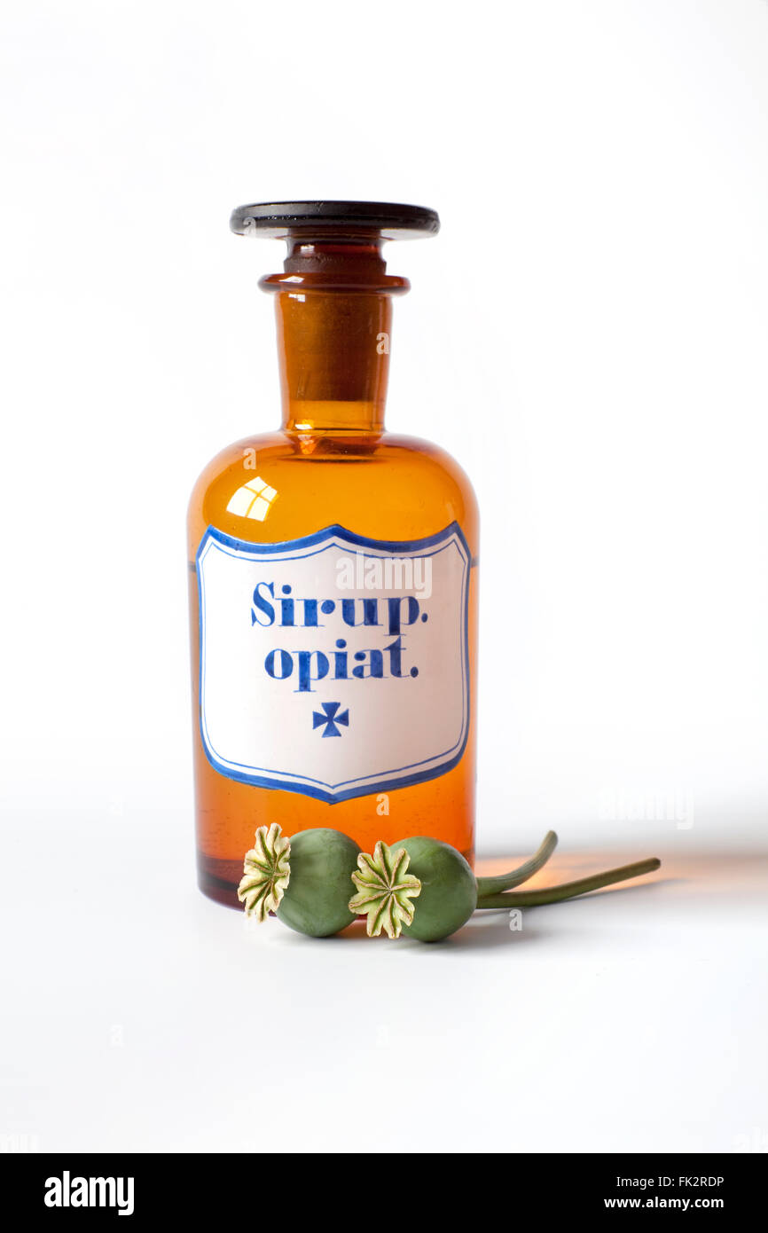 Antique Syrop Opiat Bottle With Poppy Heads on white background - Stock Image