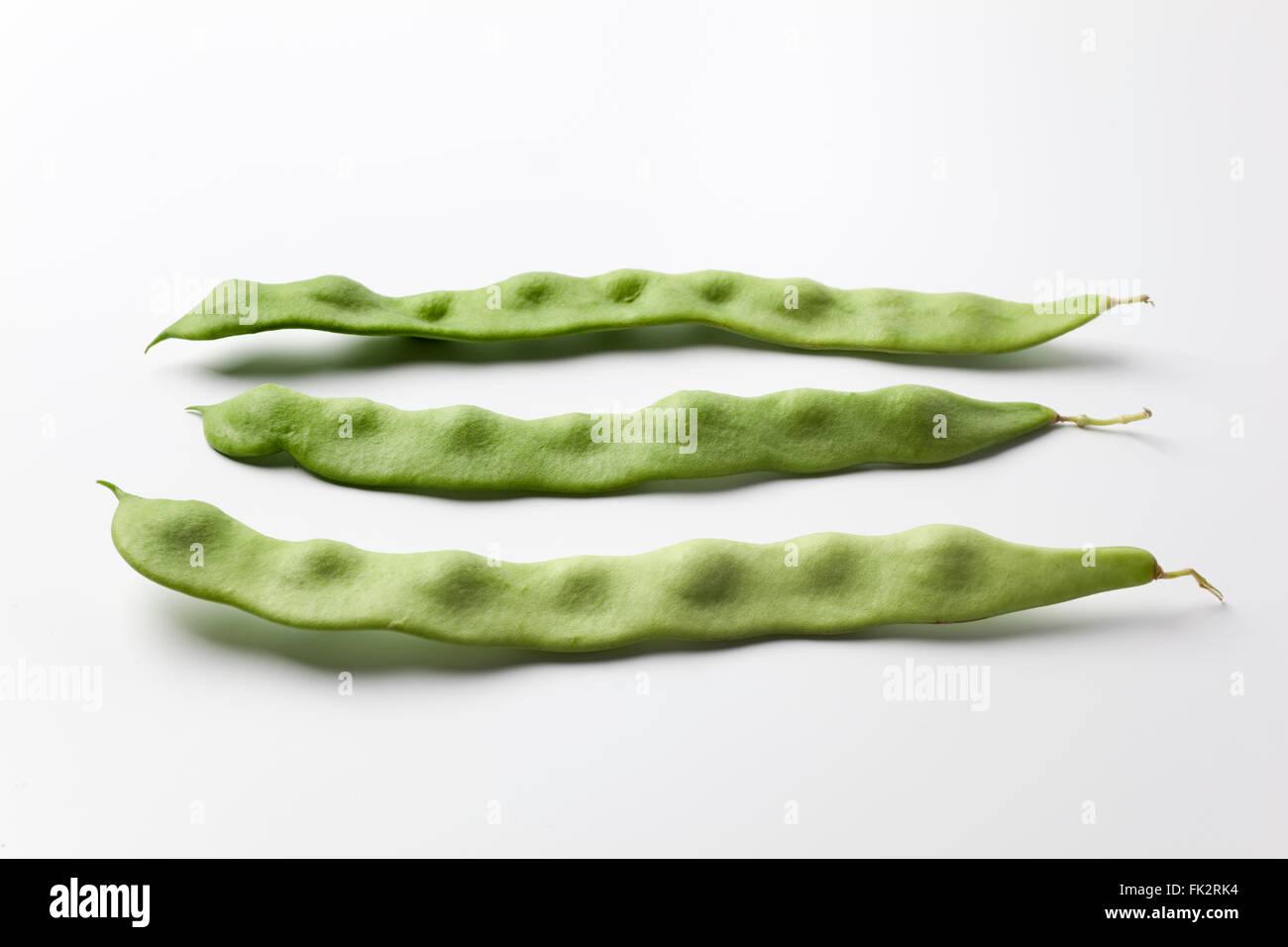 Fresh raw green pole beans on white background - Stock Image