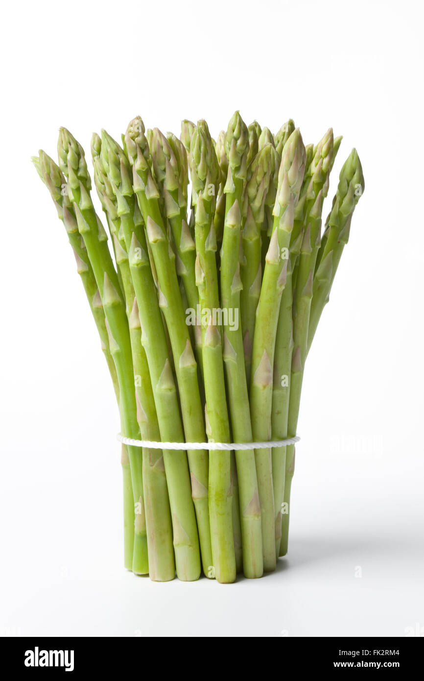 Bunch of healthy green fresh asparagus tips on white background - Stock Image