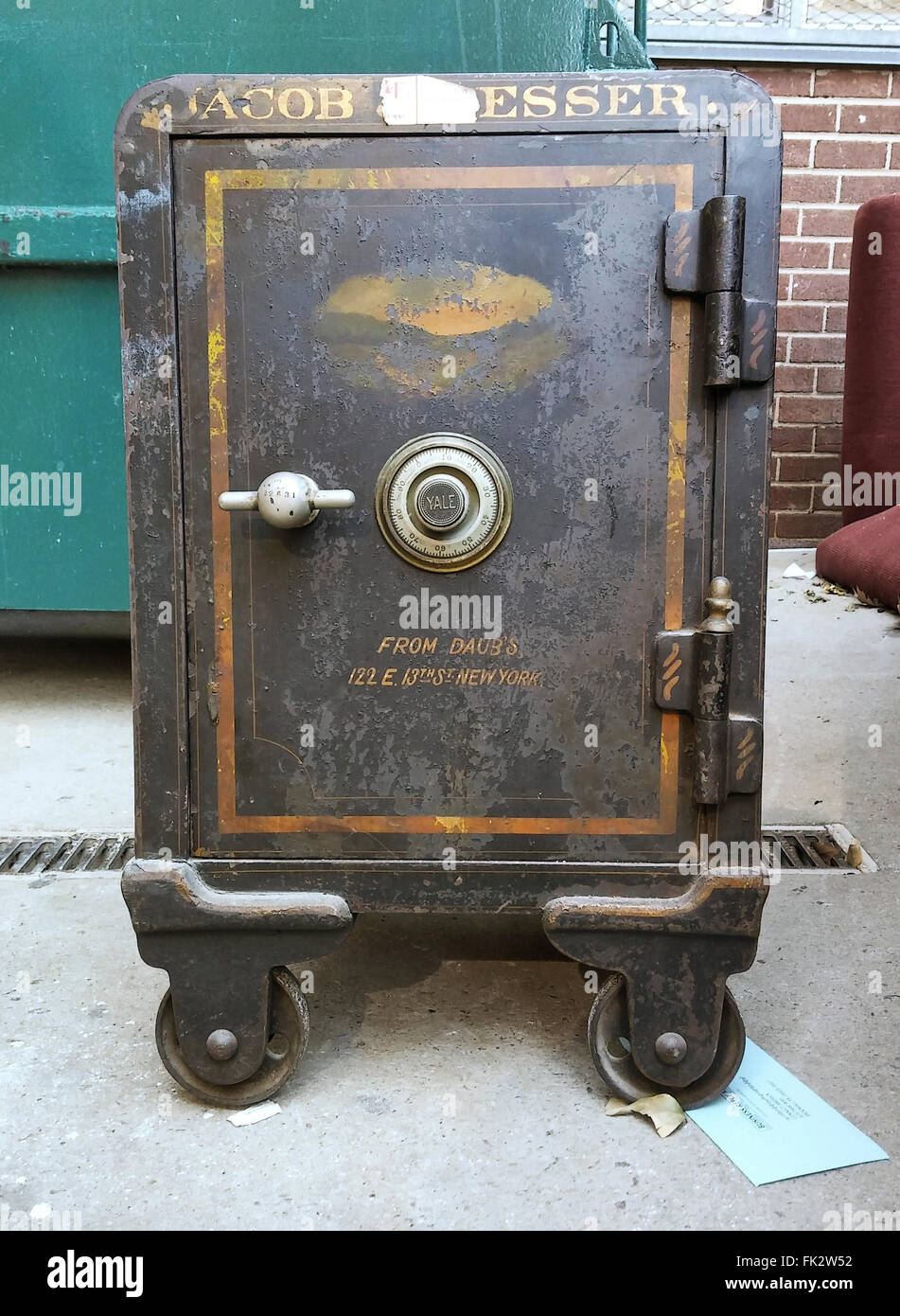 A safe is seen in the trash area of an apartment building in New York on Wednesday, March 2, 2016. (© Richard - Stock Image