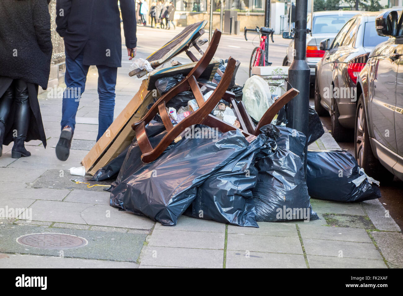 Bags of rubbish on Old Marylebone Road, London, UK - Stock Image