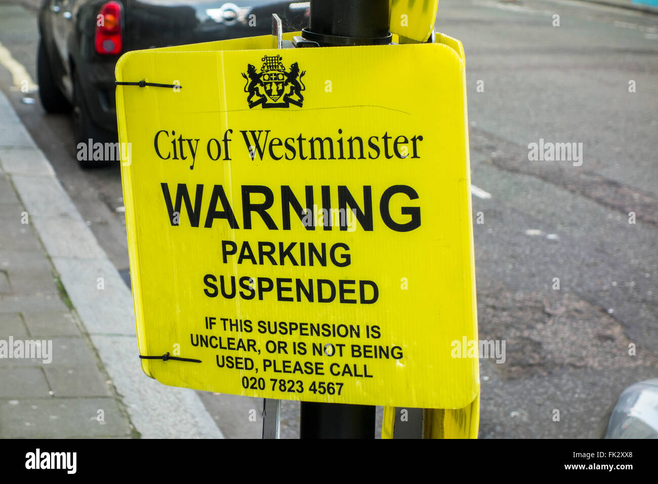 Parking suspended sign, Westminster Council, London, UK - Stock Image