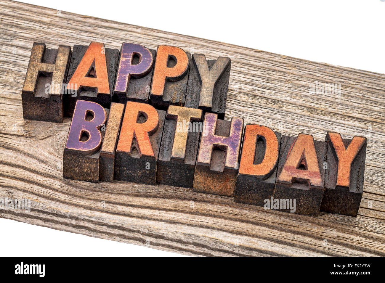 happy birthday greeting card - text  in vintage letterpress wood type printing blocks against a grained cedar plank - Stock Image