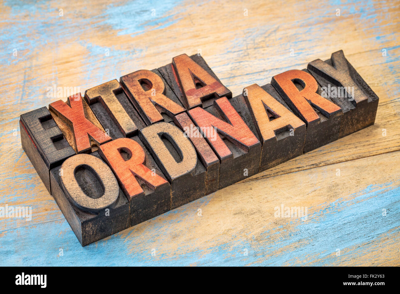 extraordinary word abstract in vintage letterpress wood type printing blocks stained by color inks - Stock Image
