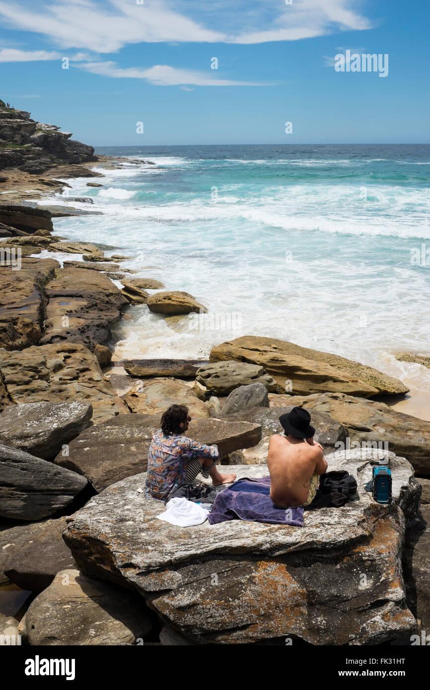 two men looking at the view along the Coogee to Bondi coastal walk, Sydney, NSW, Australia - Stock Image