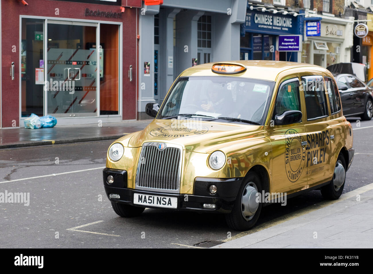 Golden Hackney Cab parked in London - Stock Image