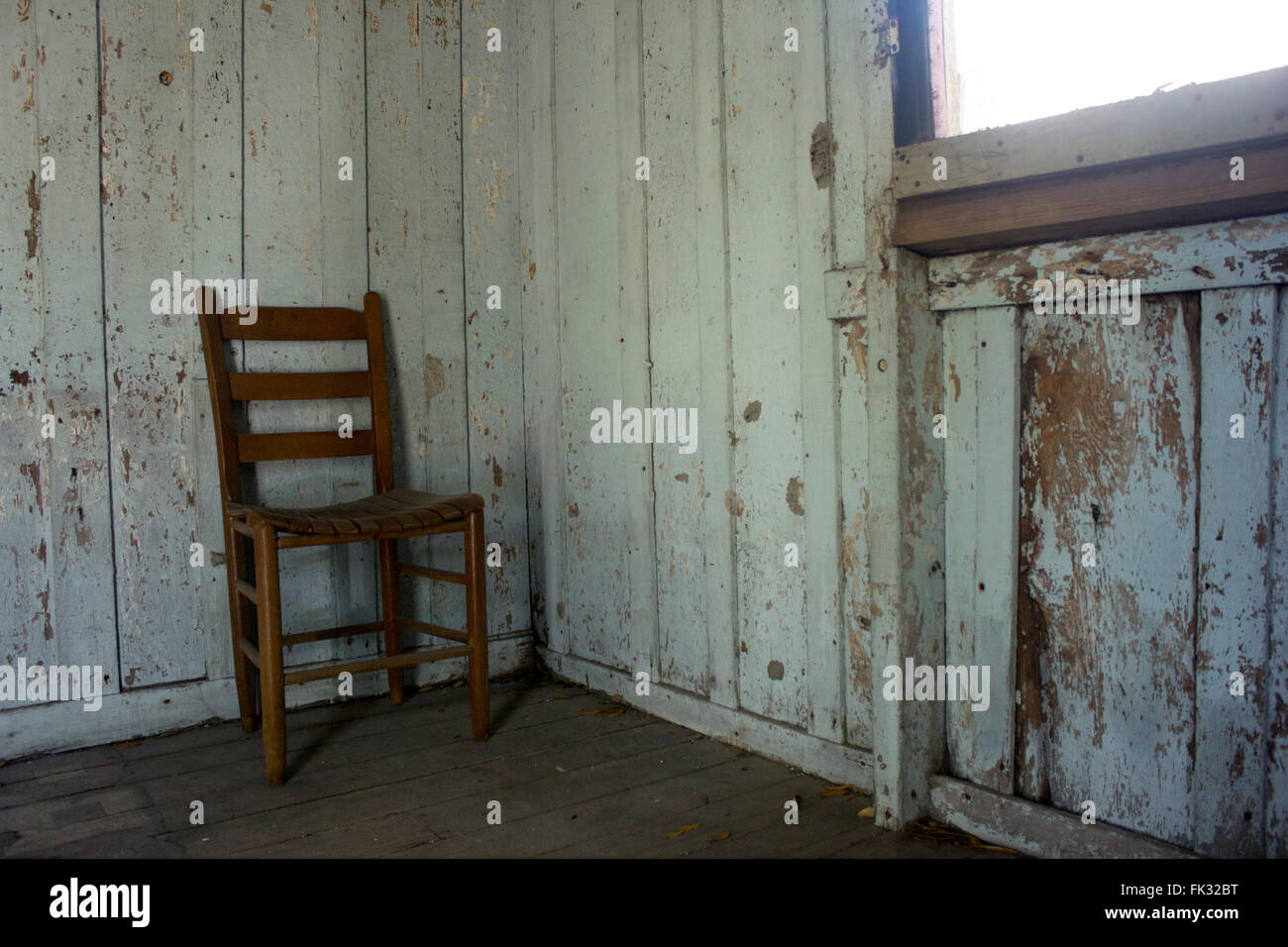 Lone chair in the room of an original slave's cabin.  Garyville, Louisiana, USA. - Stock Image