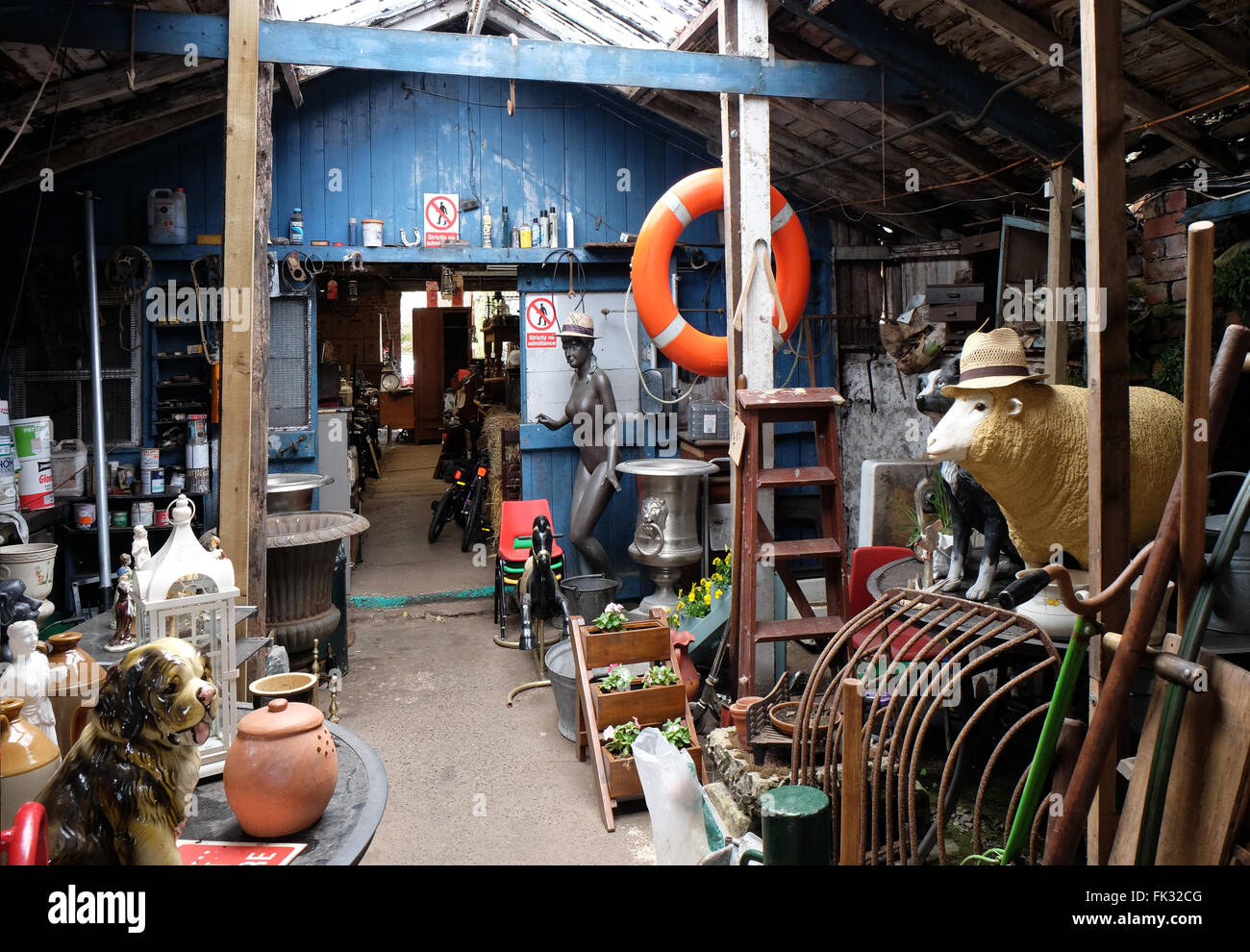 Junk shop selling a bizarre range of old recycled products - Stock Image