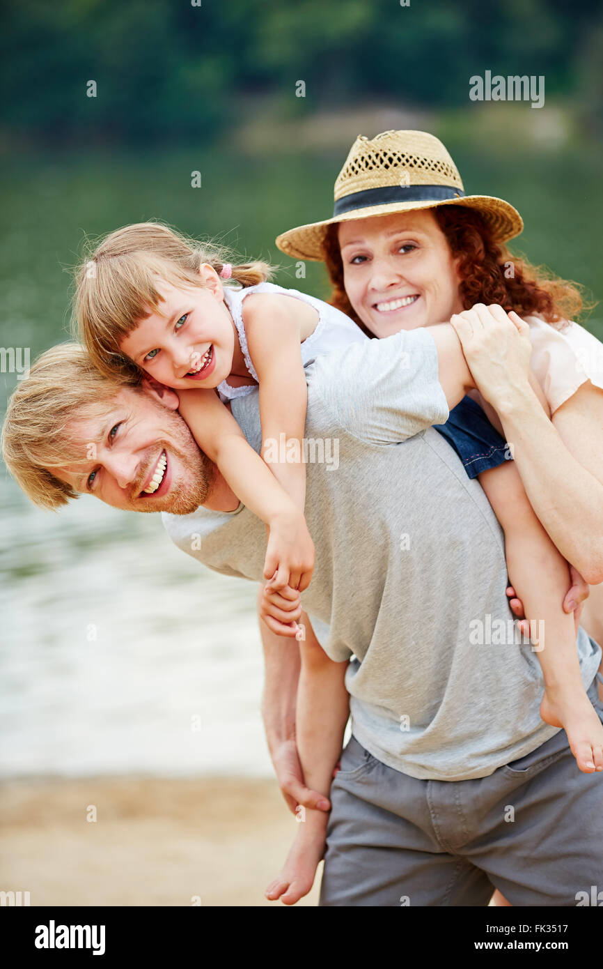 Happy family in summer at sea taking a vacation - Stock Image