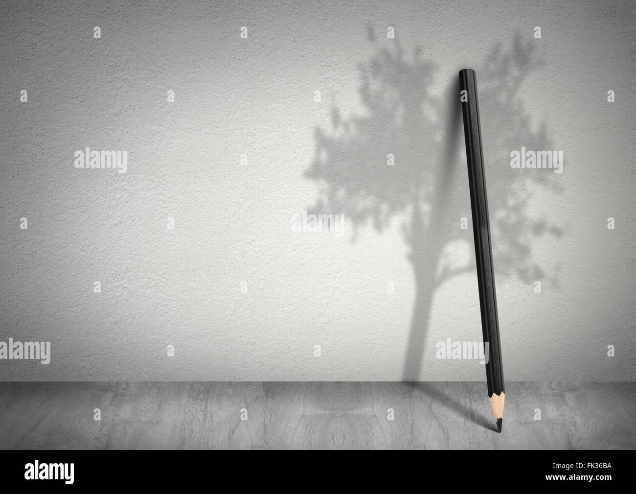Creative ecology concept, pencil with shadow of tree with copy space - Stock Image